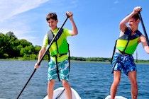 Camp mishawaka summer camp for boys and girls staff paddle board.jpg?ixlib=rails 2.1