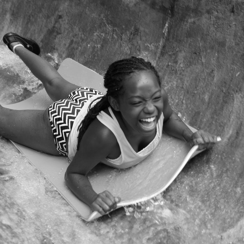 Summer camp fun water slide.jpg?ixlib=rails 2.1