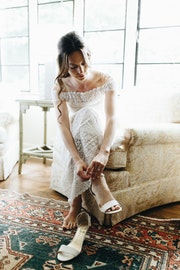 Tying on wedding heels.jpg?ixlib=rails 2.1