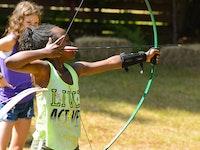 Drawing a bow on the archery range.jpg?ixlib=rails 2.1