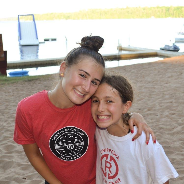 Counselor and little girl on the beach.jpg?ixlib=rails 2.1