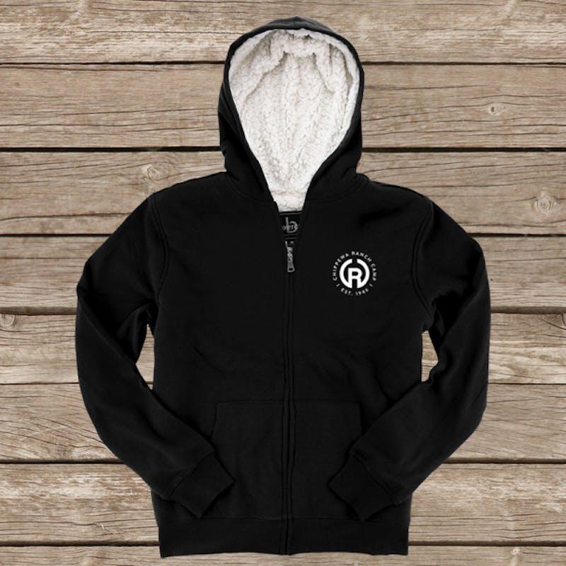 Sherpa lined fleece hoodie on wood background.jpg?ixlib=rails 2.1