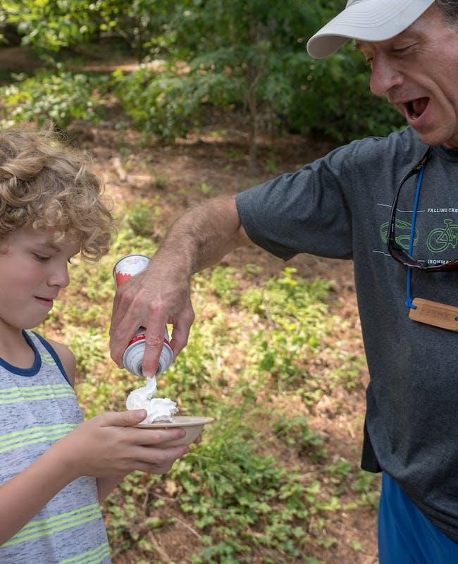Camp leadership serving whipped cream.jpg?ixlib=rails 2.1