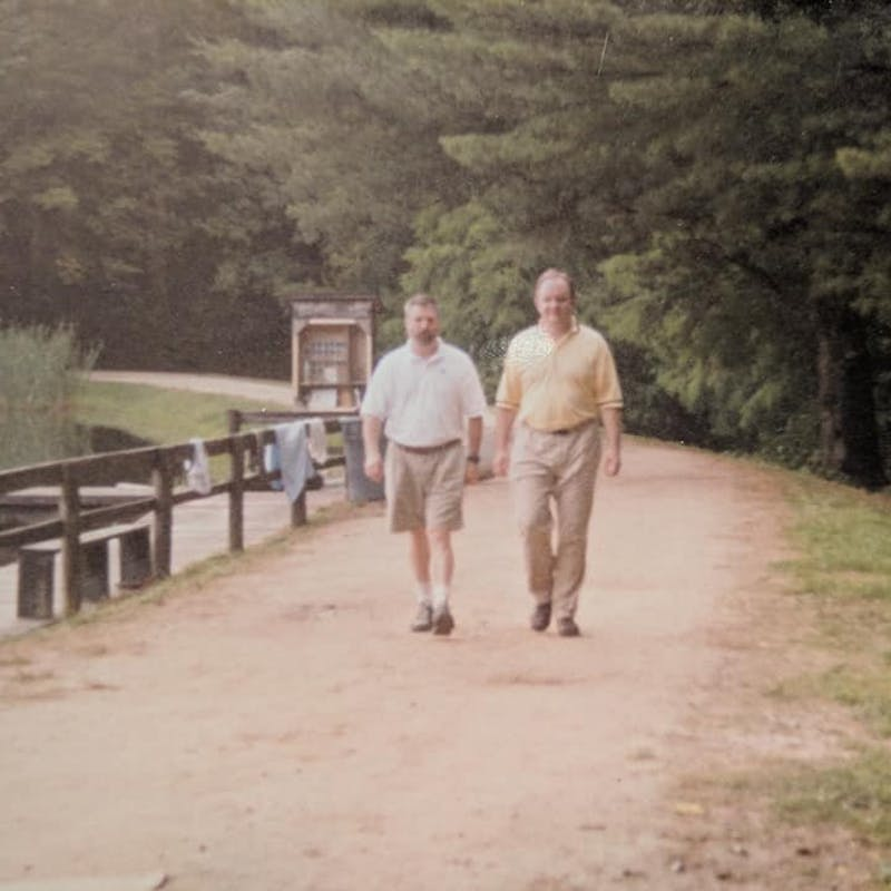 Directors donnie bain and chuck mcgrady walking along the upper dam in the 90s.jpg?ixlib=rails 2.1