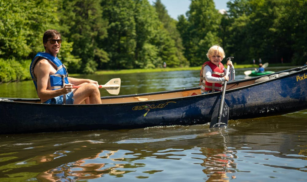 Father and son in canoe paddling.jpg?ixlib=rails 2.1