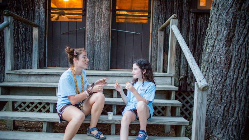 Camp sisters enjoying milk and cookies.jpg?ixlib=rails 2.1