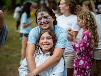 Counselor hugging camper.jpg?ixlib=rails 2.1