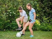 Soccer instructor and camper.jpg?ixlib=rails 2.1