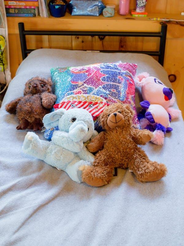 Ellies and teddies on a bed.jpg?ixlib=rails 2.1