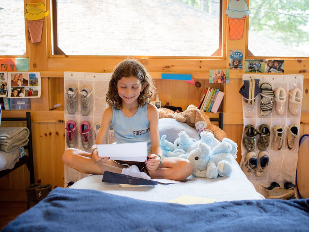 Summer camper reading mail.jpg?ixlib=rails 2.1