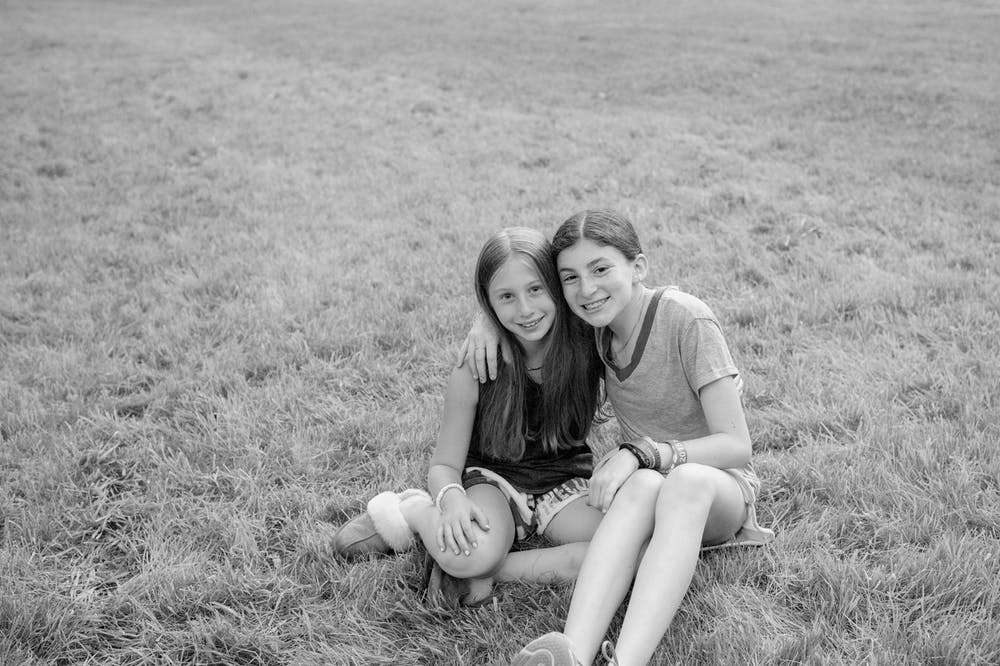 Two girls in the grass.jpg?ixlib=rails 2.1