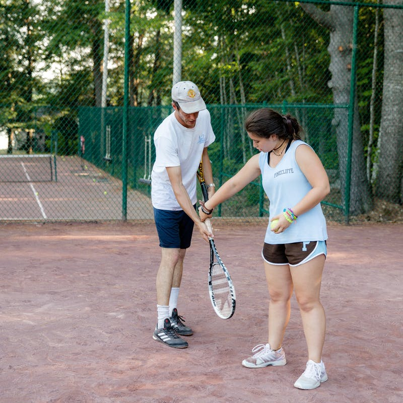 Tennis counselor corrects a grip.jpg?ixlib=rails 2.1