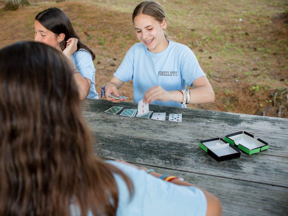 Playing cards at summer camp.jpg?ixlib=rails 2.1