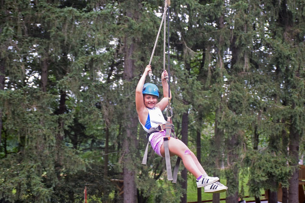 Zipline at camp saginaw summer camp for boys and girls in pennsylvania.jpg?ixlib=rails 2.1
